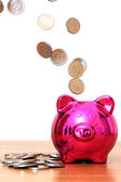 Piggy bank with pouring money — Stock Photo