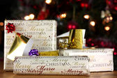 Wrapped gifts with tags — Stock Photo