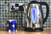 Electric kettle and cup — Stock Photo
