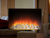 Electric fire with mirror surround — Stock Photo