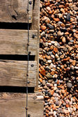 Decking and pebbles — Stock Photo