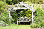 Romantic garden hideaway — Stock Photo
