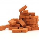 Big pile of bricks isolated — Stock Photo