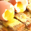 Boiled egg on toast - Stock Photo