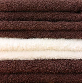 Pile of clean towels - brown and cream — Stock Photo
