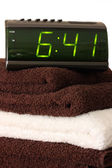Digital alarm clock on towels — Stock Photo