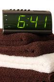 Digital alarm clock on towels — Stock Photo