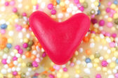 Love heart sweet on candy bobbles — Stock Photo