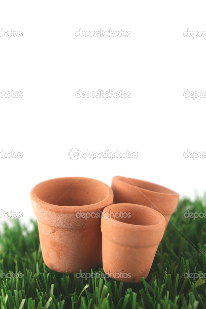 Pots on grass with copy space  Stock Photo #2449836