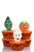Scary cup cakes on white background — Stock Photo