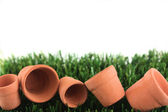 Pots and grass border with copy space — Stock Photo