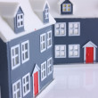 Two small houses with red doors — Stock Photo