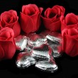 Roses and Silver Chocolate Hearts — Stock Photo #2523320