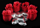 Roses and Silver Chocolate Hearts — Stock Photo
