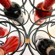 Wine bottles in curved wine rack — Stock Photo