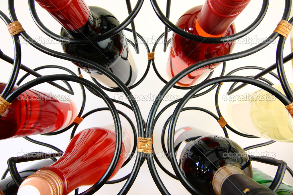 Wine bottles in curved wine rack close up  Stock Photo #2632974