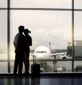 Sweethearts in airport — Stock Photo