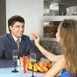 A pair of lovers at restaurant - Stock Photo