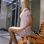 Beautiful blonde woman on bench — Stock Photo