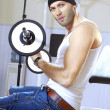 Handsome man takes exercises — Stock Photo