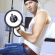 Handsome man takes exercises - Stock Photo