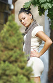 Attractive young woman in autumnal city — Stock Photo