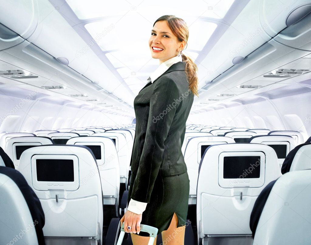 Beautiful flight attendant on board of big plane — Stock Photo #2310660