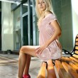 Blonde woman on bench — Stock Photo