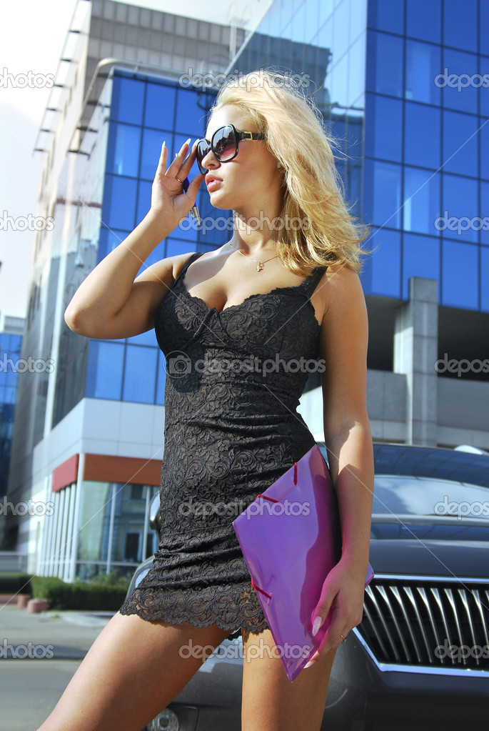 Portrait of blonde pretty business woman looking away — Stock Photo #2351456