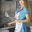 Beautiful housewife in modern kitchen — Stock Photo