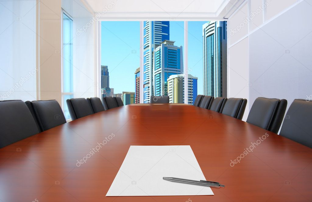 Meeting room, in front focus placed sheet of paper and pen on table  Stock Photo #2363075