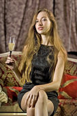 玻璃的香槟的女人 — 图库照片