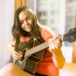 Woman with guitar — Stock Photo #2382186