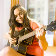 Woman with guitar - Stock Photo