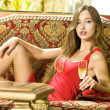 Beautiful woman on sofa w — Stock Photo