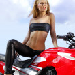 Young blonde on a motorcycle — Stock Photo