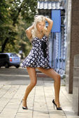 Beautiful girl in black shoes — Stockfoto