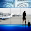 Businesswoman in airport - Stock Photo