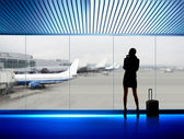 Businesswoman in airport — Stock Photo