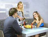 Young courting couple and waitress — Stock Photo