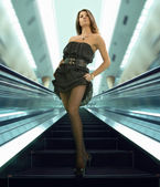 Woman on the escalator — Stock Photo