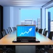 Laptop in meeting room — Stock Photo
