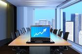 Laptop in meeting room — Stock Photo