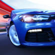 Luxury car in motion - Stockfoto