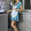 Beautiful housewife in the kitchen — Stock Photo