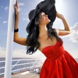 Beautiful woman in red — Stock Photo