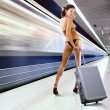 Beautiful woman with luggage in subway - Stockfoto