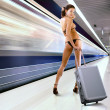 Beautiful woman with luggage in subway - Stock Photo