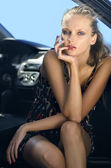 Woman in the black car — Stock Photo