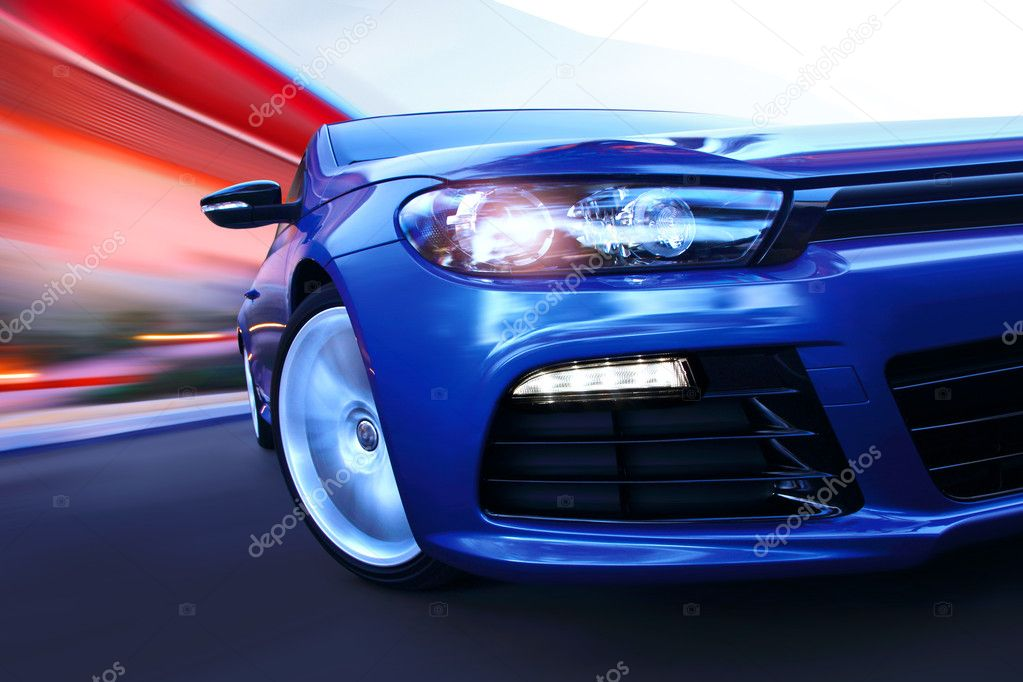 Side view of turning luxury car in motion — Stock Photo #2454614